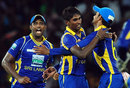 Nuwan Pradeep is congratulated after taking Rohit Sharma's wicket