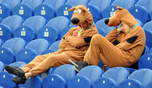 Cricket fans in fancy dress take a nap as they wait for play to resume, England v Australia, first Test, Cardiff, July 10, 2009