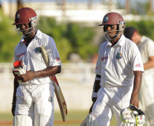 Kemar Roach and Shivnarine Chanderpaul walk back after the third day's play, West Indies v New Zealand, 2nd Test, Kingston, 3rd day, August 4, 2012