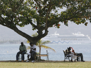 Locals and tourists sit by the sea at Montego Bay, Jamaica, March 10, 2007