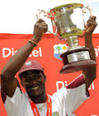Darren Sammy holds aloft the series trophy