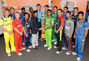 The captains of the 16 Under-19 teams pose with the World Cup trophy, Brisbane, August 6, 2012