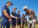Australia cricketers are welcomed during a trip to Pirlangimpi of the Tiwi Islands, August 10, 2012