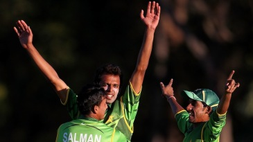 Zia-ul-Haq is embraced by team-mates