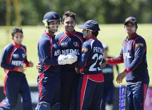 The Nepal team celebrates the fall of an Australian wicket, Australia v Nepal, Group A, ICC Under-19 World Cup 2012, Townsville, August 13, 2012