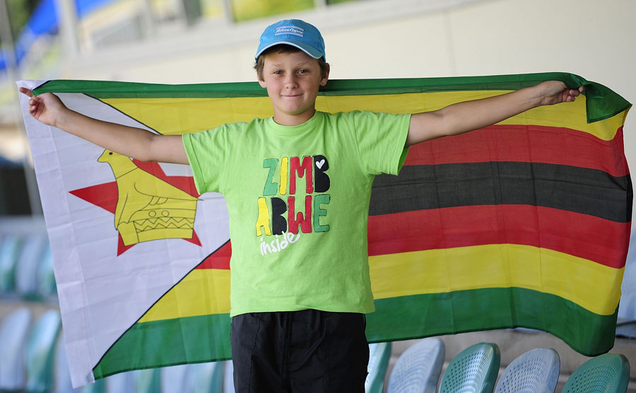 A young spectator shows his support for Zimbabwe