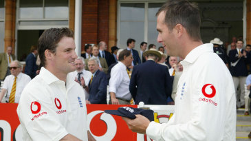 Debutant Andrew Strauss gets his Test cap from Michael Vaughan