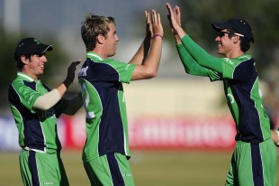 Graeme McCarter and George Dockrell celebrate a wicket