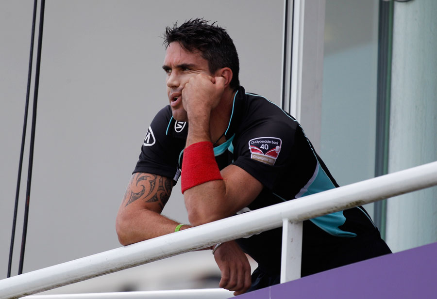 Kevin Pietersen looks on from the balcony after his first-ball duck