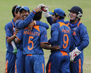 India's bowlers put in a commanding performance to restrict Pakistan's batsmen