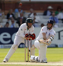 Graeme Swann reverse sweeps as he also tried to boost England's chase