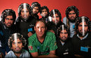 Shane Warne poses with children wearing Lasith Malinga masks