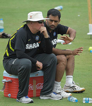 MS Dhoni and Duncan Fletcher have a word during a training session, Hyderabad, August 21, 2012