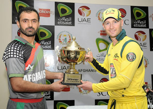 Afghanistan's Nawroz Mangal and Michael Clarke unveil the one-off ODI trophy, Sharjah, August 23, 2012