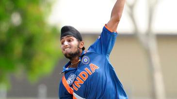 Harmeet Singh bowls