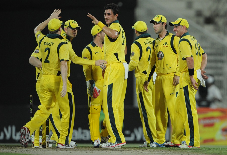 Mitchell Starc celebrates after dismissing Karim Sadiq