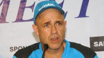 Richard Pybus addressing a press conference