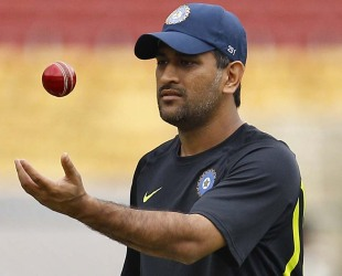 MS Dhoni tosses the ball in a practice session, Bangalore, August 29, 2012
