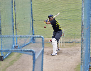 Virender Sehwag lets the ball go during a training session