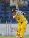 Michael Clarke drives one through the off side