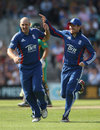 James Tredwell celebrates a wicket with Eoin Morgan