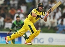 Michael Hussey flicks one through leg on his way to a half-century