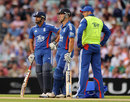 Ravi Bopara and Jonathan Trott watch the big screen during an decision review