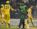 The winning captain Misbah-ul-Haq is congratulated by David Hussey