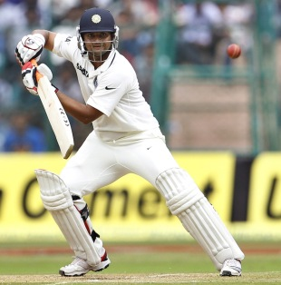 Suresh Raina guides one towards the off-side, India v New Zealand, 2nd Test, Bangalore, 2nd day, September 1, 2012