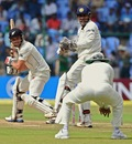 Daniel Flynn edges the ball into the hands of Virender Sehwag