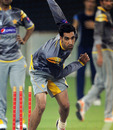 Umar Gul bowls at a nets session