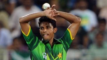 Raza Hasan runs in to bowl