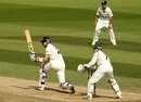 Kevin Pietersen plays into the leg side as Chris Read looks on