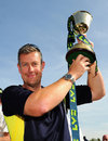 Ashley Giles holds the County Championship trophy aloft