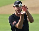 Daniel Vettori catches a ball during practice