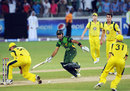 Umar Akmal completes the winning run in the Super Over, Pakistan v Australia, 2nd T20I, Dubai, September 7, 2012