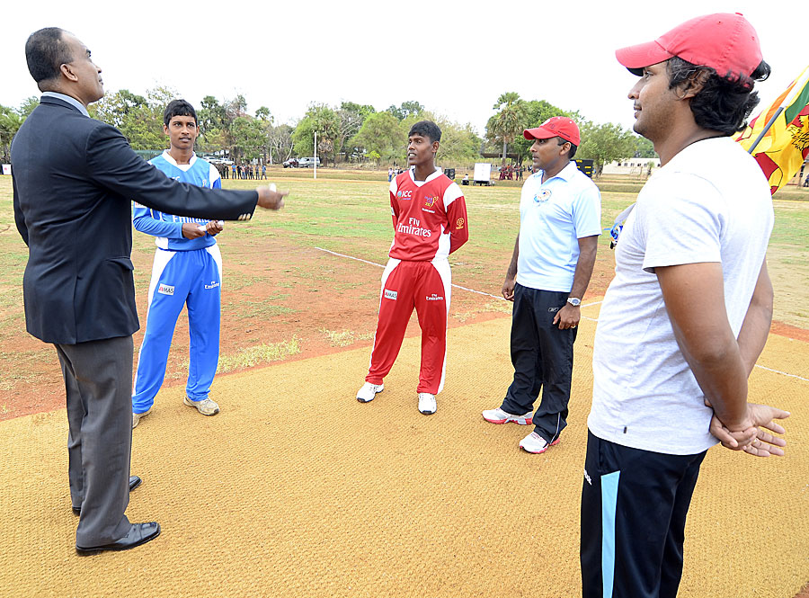 Kumar Sangakkara and Mahela Jayawardene watch the first toss at Oddusuddan Oval at Mullaitivu