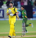 Cameron White walks off after being bowled by Saeed Ajmal