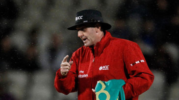 Umpire Rob Bailey gives the final signal to leave the field for good