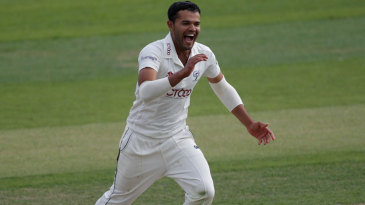 Azeem Rafiq celebrates one of his three wickets