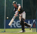 Dan Christian has a bat in the nets