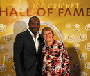 Brian Lara with Enid Bakewell of England, after being inducted into the Hall of Fame