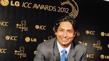 Kumar Sangakkara smiles after receiving three awards