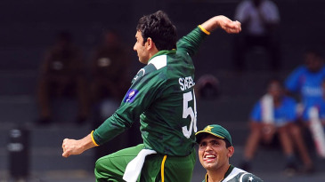 Saeed Ajmal celebrates after taking a wicket
