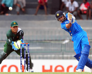 Virat Kohli steps down the track to loft a ball, India v Pakistan, World Twenty20 warm-ups, Colombo, September 17, 2012