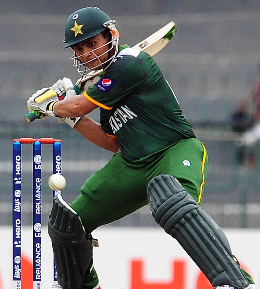 Kamran Akmal prepares to play the cut
