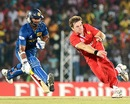 Kyle Jarvis attempts a run-out against Kumar Sangakkara