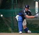 Stuart Broad attempts a sweep in the nets