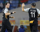 Kyle Mills celebrates a wicket with Daniel Vettori