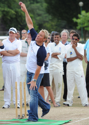 Shane Warne demonstrates his bowling skills, London, July 2, 2010